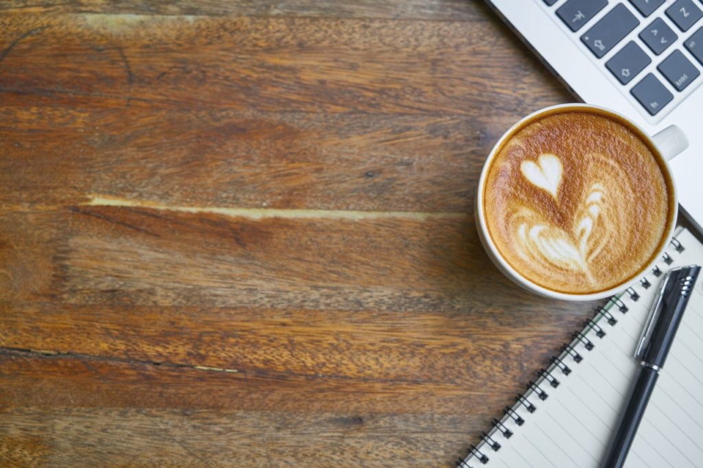 Coffee with MacBook and Notepad